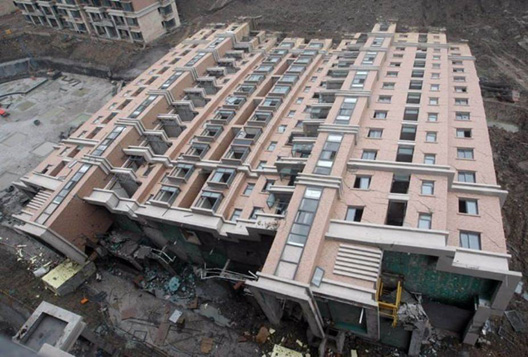 building-tipped-over